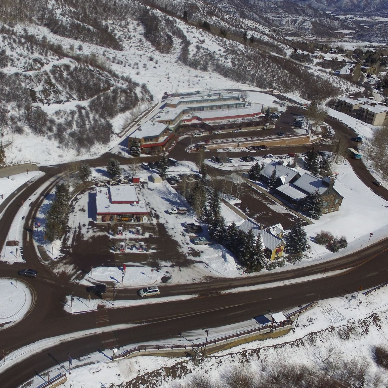 aerial photo overlooking the snowmass center and roundabout in winter time
